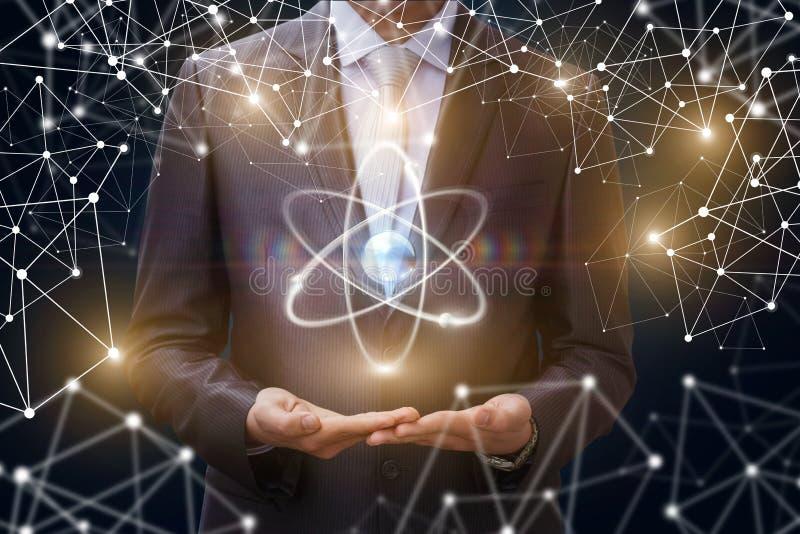 Mostra do homem de negócios do átomo imagens de stock