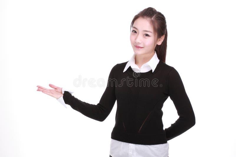 Mostrando donna di affari isolata su bianco fotografia stock