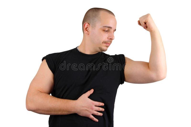 Mostrando o bíceps fotografia de stock royalty free