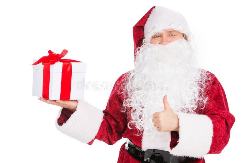 Mostrar gordo velho de Santa Claus atual e manter o polegar. fotos de stock