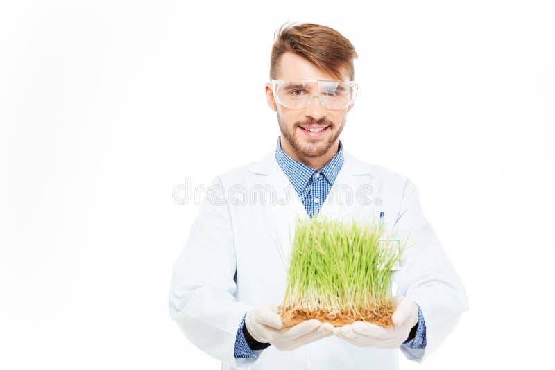 Mostrar masculino feliz do coordenador plantas alteradas fotos de stock