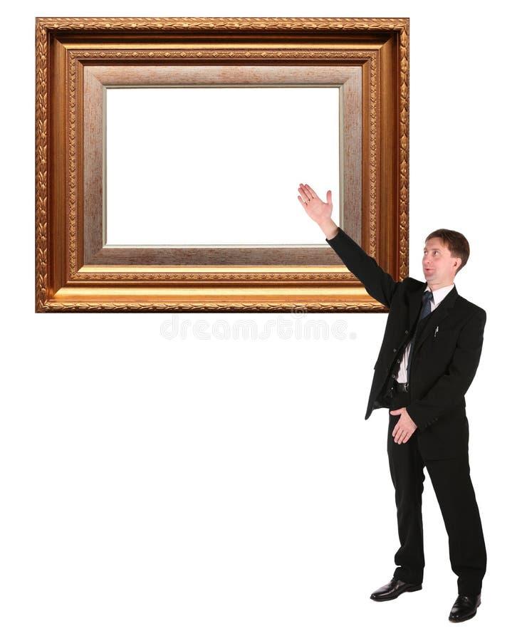 Mostras do homem de negócios no baget do frame de retrato fotos de stock royalty free
