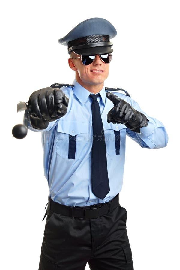 Mostras do polícia com cassetete imagens de stock