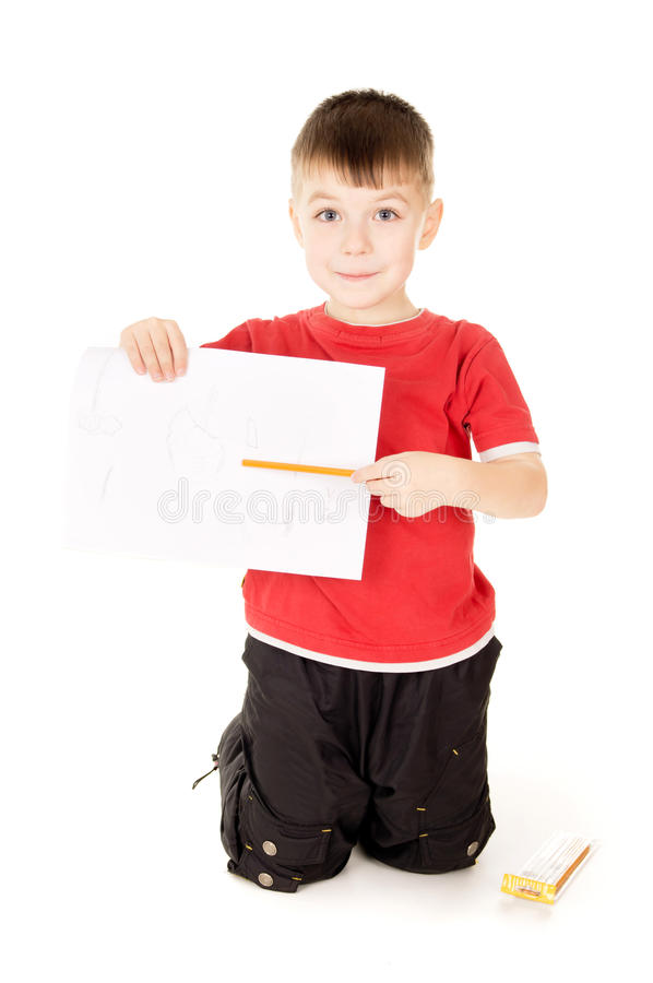 Mostras do rapaz pequeno que desenha foto de stock