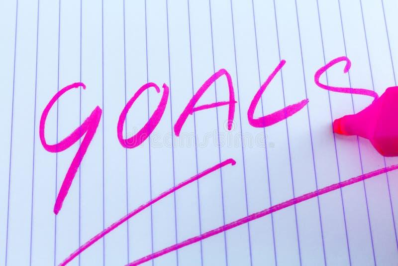 Mot-clé de buts écrit avec le marqueur rose image stock