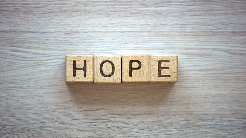 Mot d'espoir fait en croyance de cubes, pure et véritable dans un dieu, des prières et des bénédictions photographie stock libre de droits