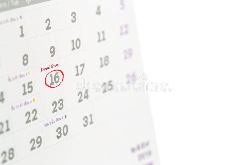 Mot de date-butoir écrit sur le calendrier photos stock
