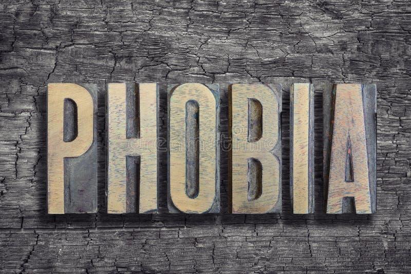 Mot de phobie brûlé en bois photo stock