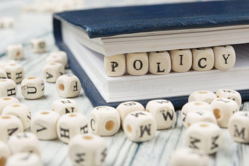 Mot de politique écrit sur le bloc en bois ABC en bois photographie stock libre de droits