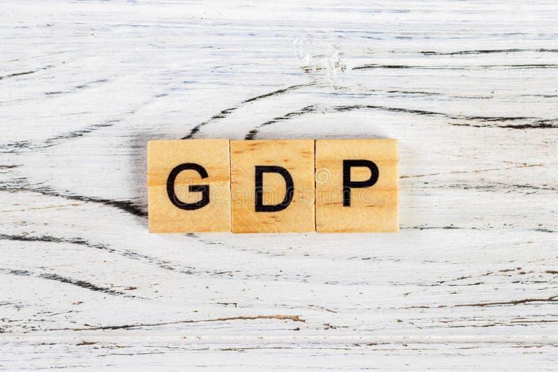 Mot de produit intérieur brut de PIB fait avec le concept en bois de blocs photo stock