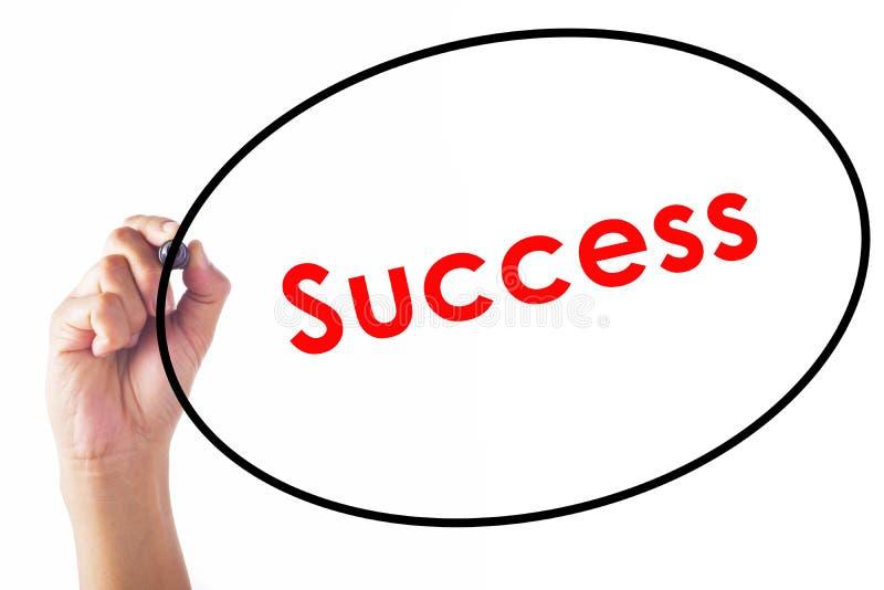 Mot de succès d'écriture d'homme d'affaires avec le stylo photos stock