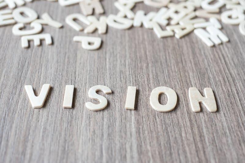 Mot de VISION des lettres en bois d'alphabet Affaires et idée image stock