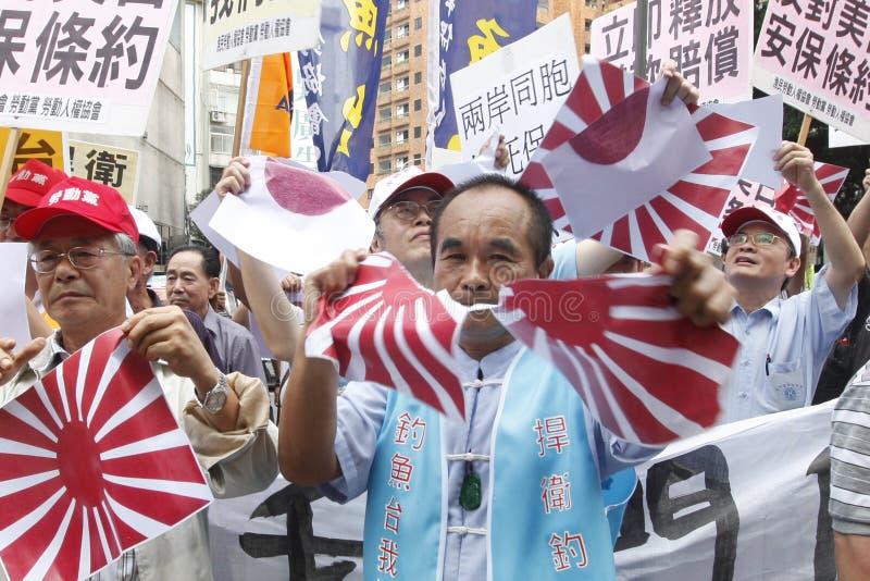 mot den japan protesten royaltyfri foto