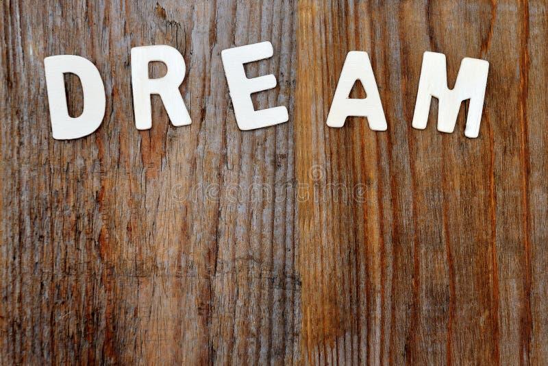 Mot rêveur sur le fond en bois image libre de droits