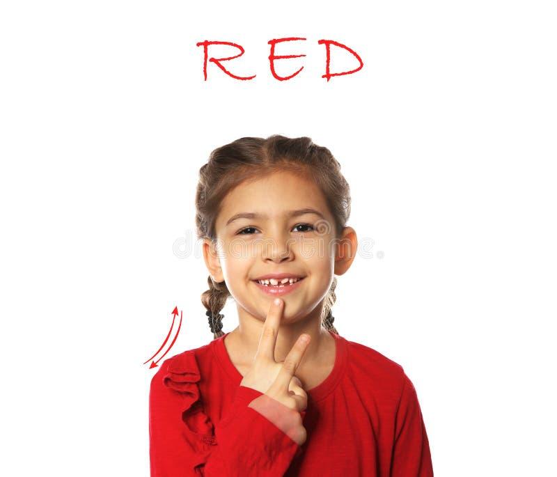 Mot ROUGE d'apparence de petite fille sur le fond blanc photo libre de droits