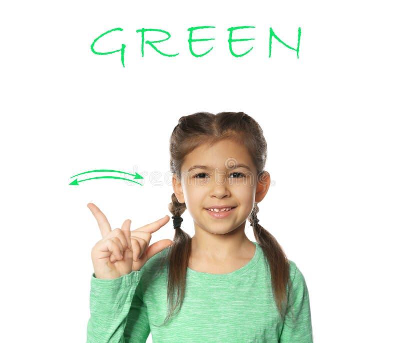 Mot VERT d'apparence de petite fille sur le blanc Langue des signes images stock