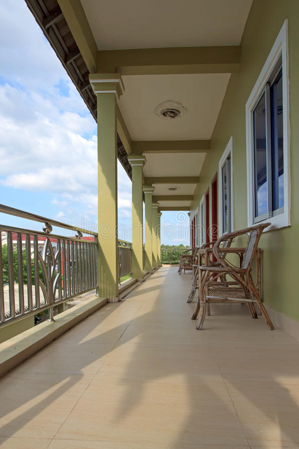 Motel balcony with wooden chairs and tables. Guesthouse balcony with wooden chairs and tables stock photos