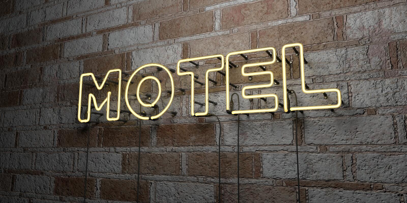 MOTEL - Señal de neón que brilla intensamente en la pared de la cantería - 3D rindió el ejemplo común libre de los derechos stock de ilustración