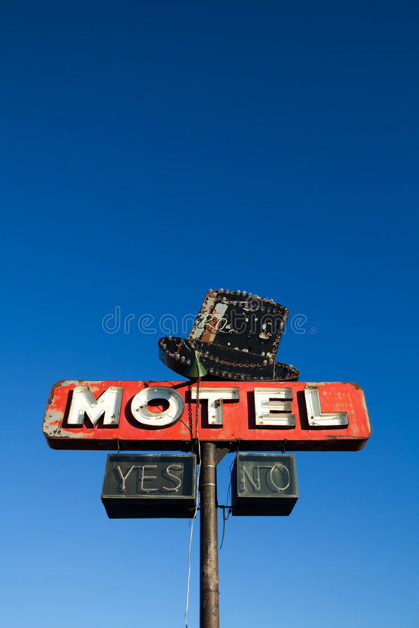 Motel sign against blue sky stock images