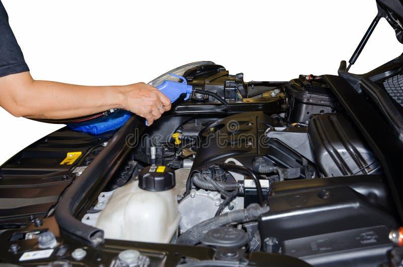 Moteur de voiture de nettoyage par pression de pistolet pneumatique photo stock