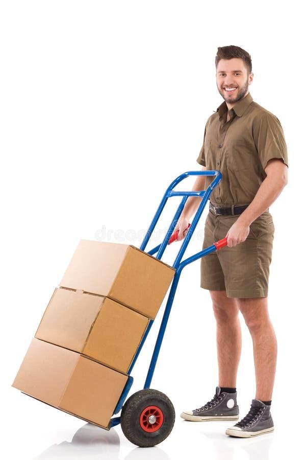 Moteur posant avec un chariot de livraison image libre de droits