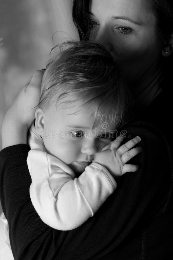 Mother. Portrait of melancholic mother holding her baby stock photos