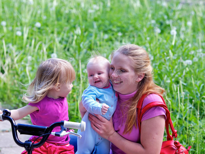 Download Mother And 2 Daughters In Park Stock Photo - Image of little, bike: 20083654
