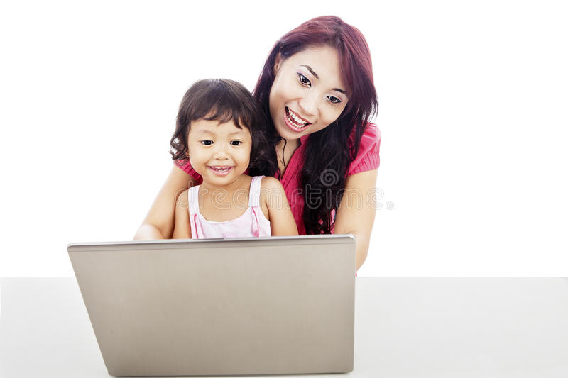 Download A Mother Accompany Her Child To Use Internet Stock Image - Image of asian, computer: 26813609