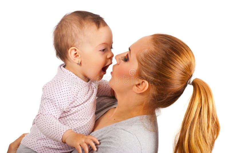 Mother And Amazed Baby Girl Stock Photo