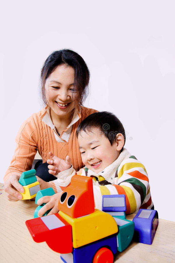 Free Mother And Child Playing With Toys Royalty Free Stock Image - 8425376
