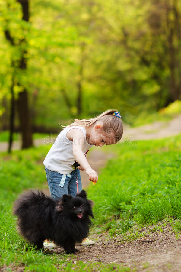Free Mother And Child Walking Playing With Dog Royalty Free Stock Images - 24732529