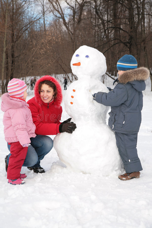 Free Mother And Children Make Snowman Stock Image - 4865011