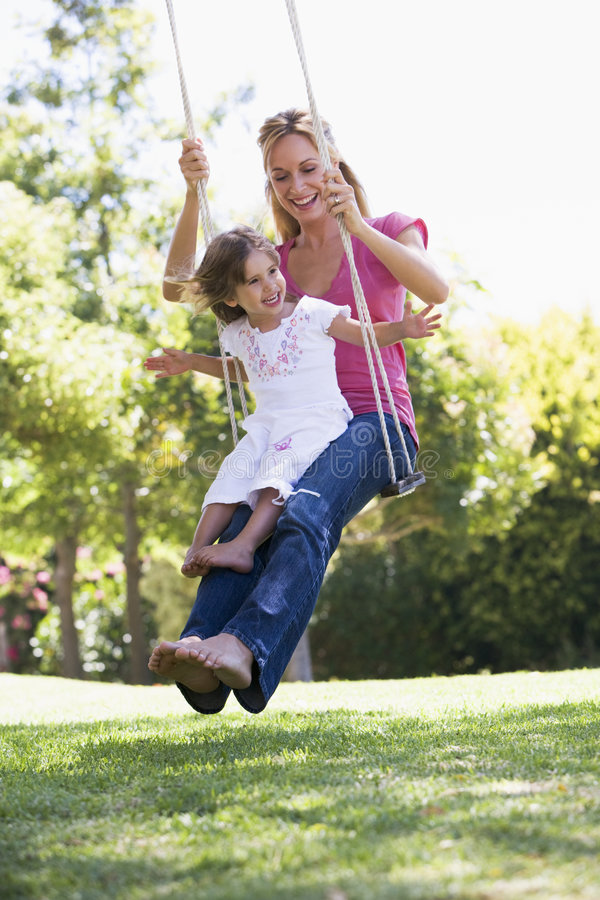 Free Mother And Daughter On Garden Swing Stock Photo - 4849930