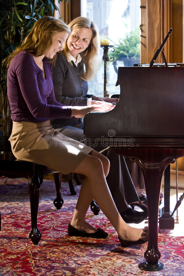 Free Mother And Daughter Piano Duet Royalty Free Stock Photography - 10649787