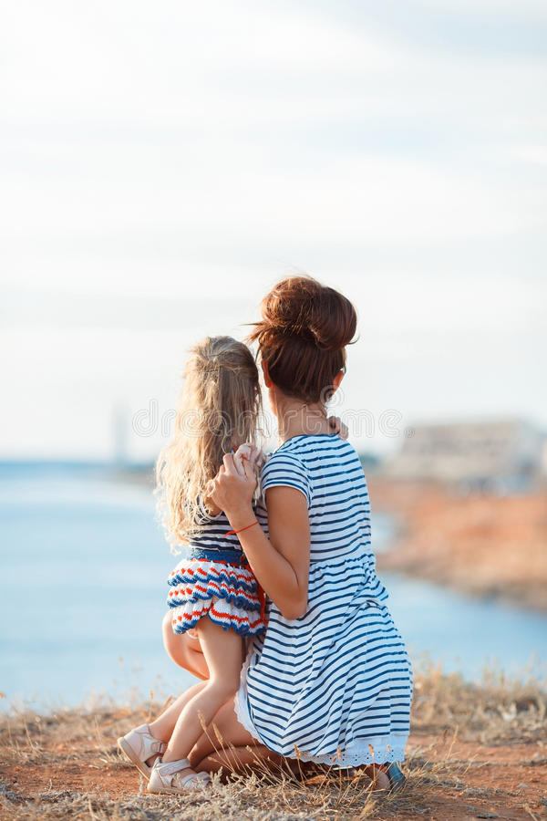 Free Mother And His Adorable Little Daughter At Beach Stock Images - 66650404