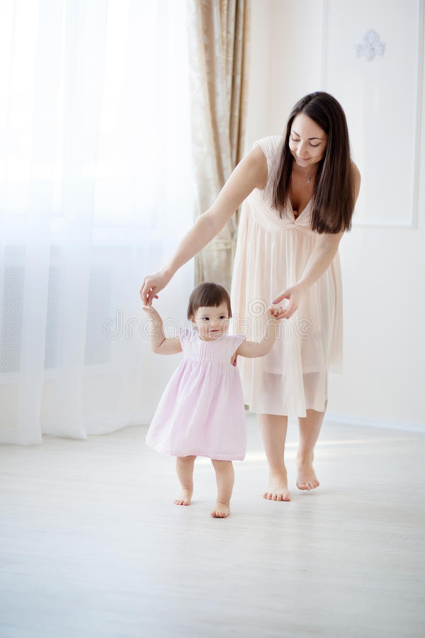 Free Mother And Little Daughter Playing In The Bedroom Stock Photos - 51915153