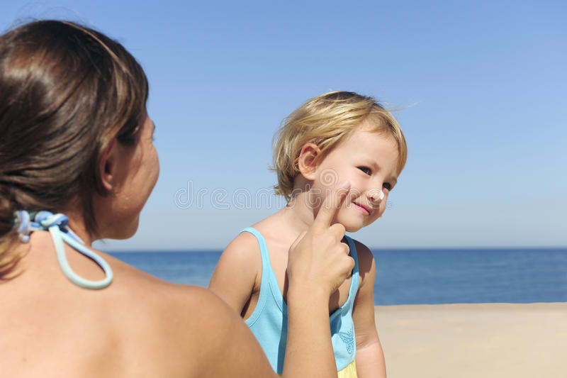 Download Mother Applying Suntan Lotion To Her Daughter Stock Image - Image: 15030797
