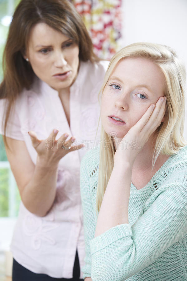 Mother Arguing With Teenage Daughter. Angry Mother Arguing With Teenage Daughter stock photography