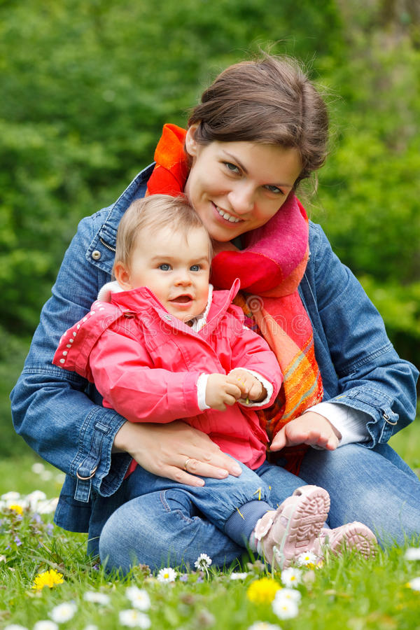 Download Mother with baby stock image. Image of cute, girl, green - 19756777