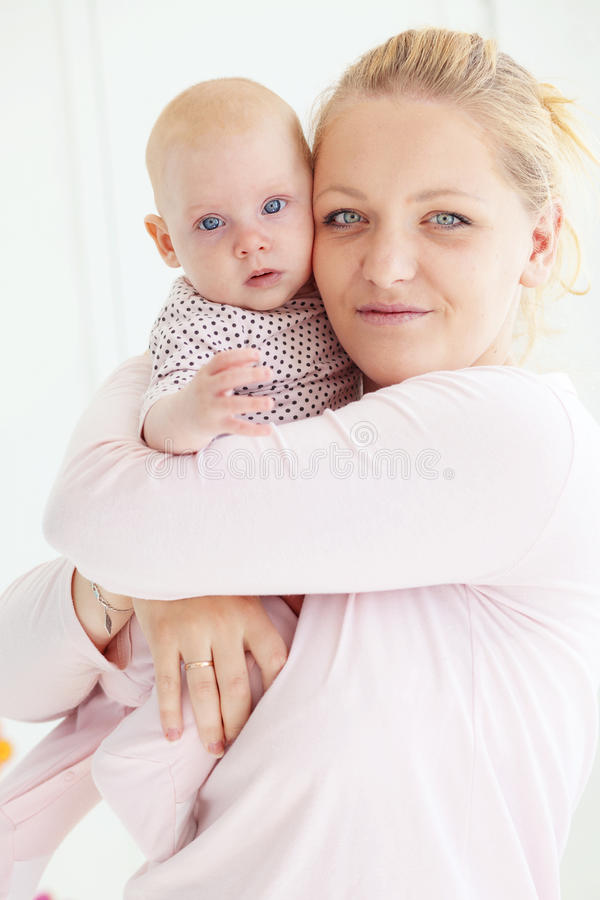 Download Mother with a baby stock image. Image of holding, blond - 26409115