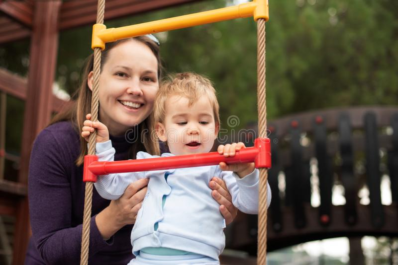 Mother and Baby Boy Playing At Playground royalty free stock photography
