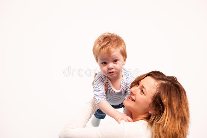 Mother and baby boy playing together royalty free stock photo