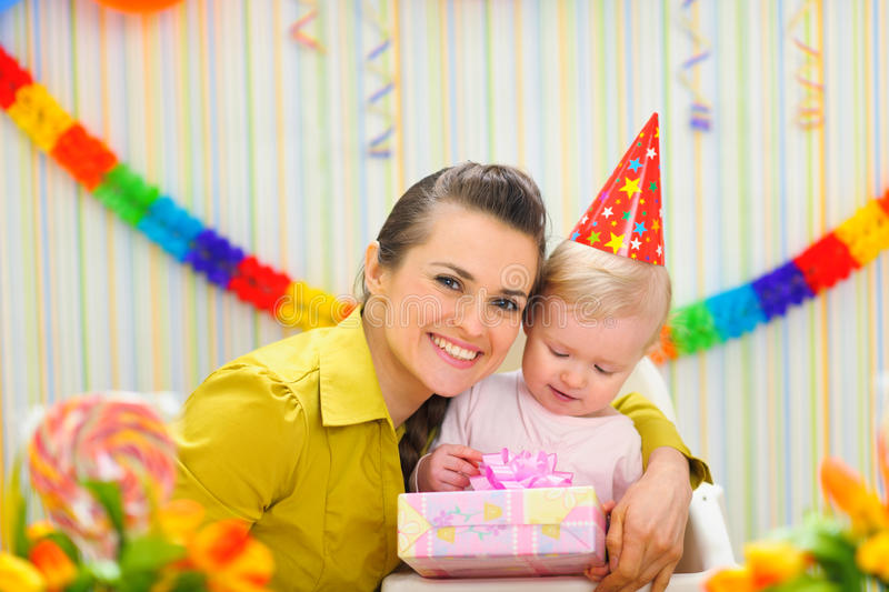 Mother with baby celebrating first birthday. Portrait of mother with baby celebrating first birthday stock image
