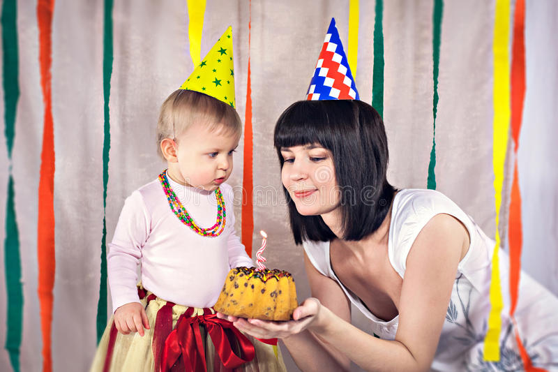 Mother with baby celebrating first birthday. Portrait of mother with baby celebrating first birthday royalty free stock photos
