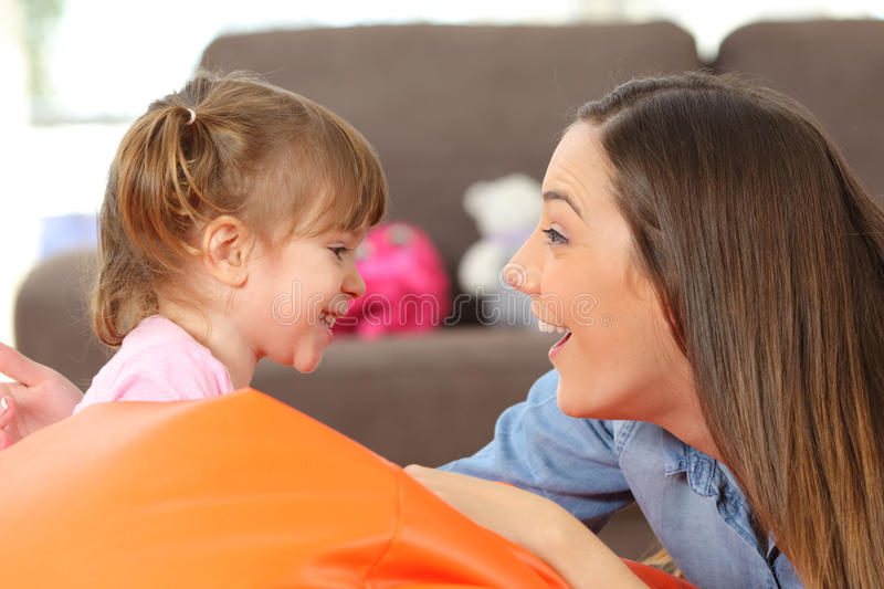 Mother and baby daughter facing stock image