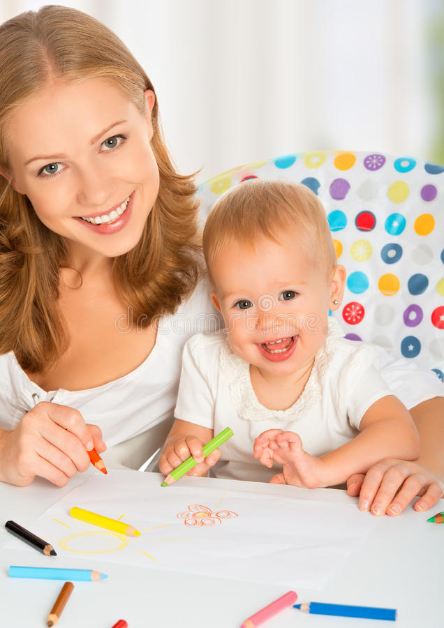 Mother and baby draw color pencil. Crayons royalty free stock photo