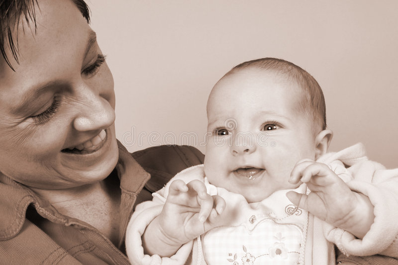 Mother with Baby in dreamland. Young mother with baby in dreamland royalty free stock photo