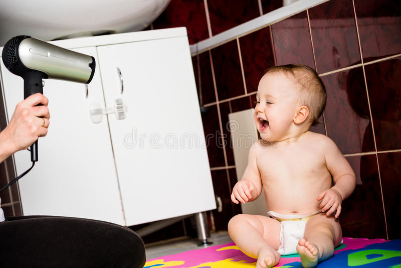 Mother and baby - drying hairs royalty free stock photography