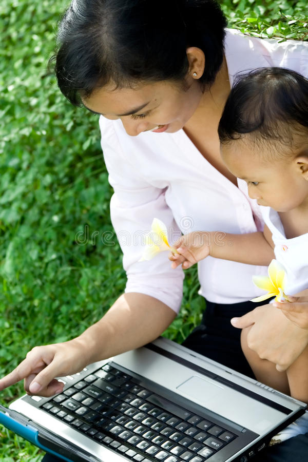 Mother and baby fun with a laptop royalty free stock photo