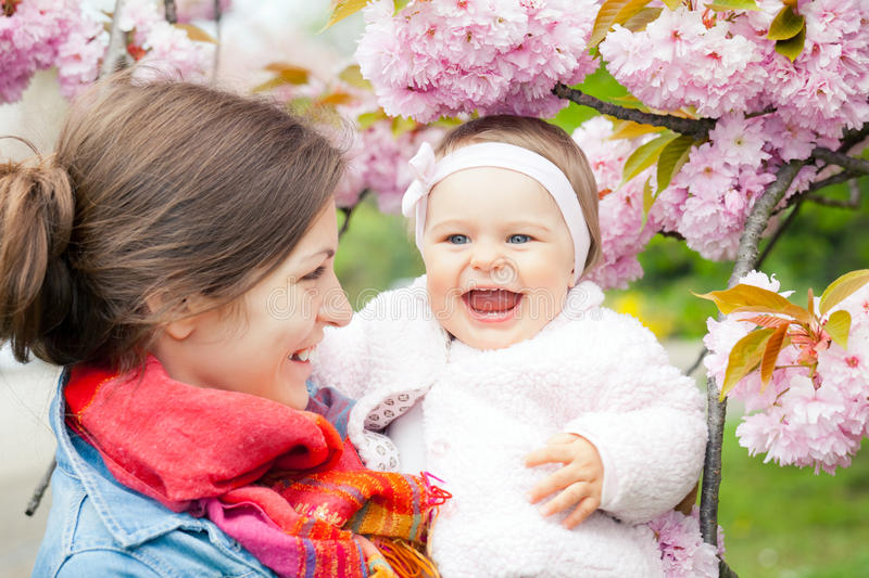 Download Mother With Baby In The Garden Stock Photo - Image: 23318772